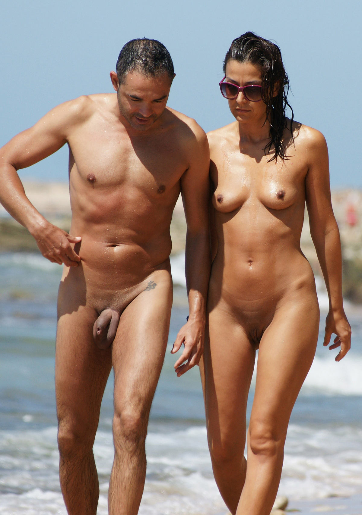 men naked at beach couple